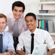 Young men at a computer — Stock Photo