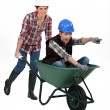Woman being pushed in wheelbarrow — Stock Photo