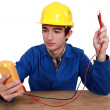 Electrician using tester - Stockfoto