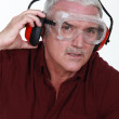 Senior man with goggles and protective headphones — Stock Photo
