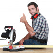 Woodworker using circular saw — Stock Photo #10002004