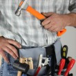 Cropped shot of a handyman with a hammer - Stock Photo