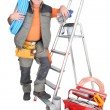 Stock Photo: Man with ladder and plumbing tools