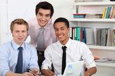 Young men at a computer — Stock Photo