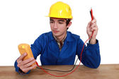 Electrician using tester — Stock Photo