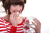 Woman eating marshmallows — Stock Photo