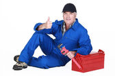 Approving tradesman posing with his tools — Stock Photo