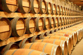 Barrels in a cellar — Stock Photo
