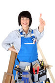 Female carpenter giving the thumbs-up — Stock Photo