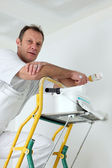 Decorator hard at work — Stock Photo