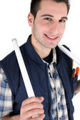 Electrician holding replacement bulbs — Stock Photo