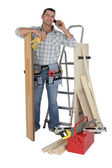 Handyman talking to a supplier — Stock Photo