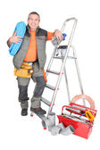 Man with ladder and plumbing tools — Stock Photo