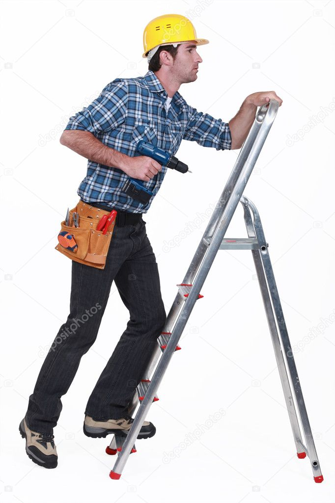 A handyman climbing a ladder.  Stock Photo #10002212