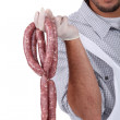 A butcher holding sausages. — Stock Photo #10010292