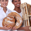Two bakery workers holding bread — Stock Photo #10010525