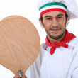 Young black pizza cook taking a spade — Stock Photo #10010862