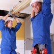 Electricians installing neon on ceiling — Stock Photo #10011811