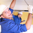 Electricians working on roof — Stock Photo