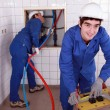 Two plumber working in restroom — Stock Photo