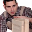 Carpenter building a cupboard — Stock Photo