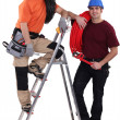 Stock Photo: A team of tradesmen posing with their tools