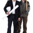 Architect stood by worker with sledge-hammer — Stock Photo