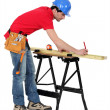 Carpenter marking a piece of wood — Stock Photo #10015761