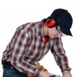 Man using router on plank of wood - Stock Photo