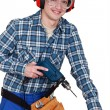 Man operating a power tool — Stockfoto