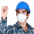 Stock Photo: Young builder wearing a mask