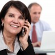Woman on the phone with technicien — Stock Photo #10018619