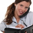 Pretty businesswoman on the phone holding agenda — Stock Photo #10018714