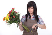 Florist cutting stems off flowers — Stock Photo