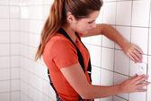 Woman fitting plug — Stock Photo