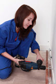Woman with drill — Stock Photo