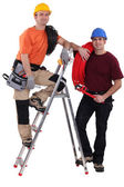 A team of tradesmen posing with their tools — Stock Photo