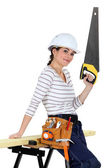Brunette carpenter with saw — Stock Photo