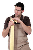 Carpenter with lumber — Stock Photo
