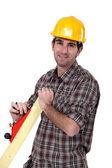 Man with wood plane — Stock Photo