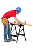 Carpenter marking a piece of wood — Stock Photo