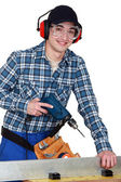 Man operating a power tool — 图库照片