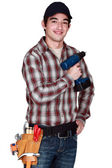 Young man with drill in hand — Stock Photo
