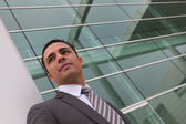 Businessman outside an office building — Stock Photo