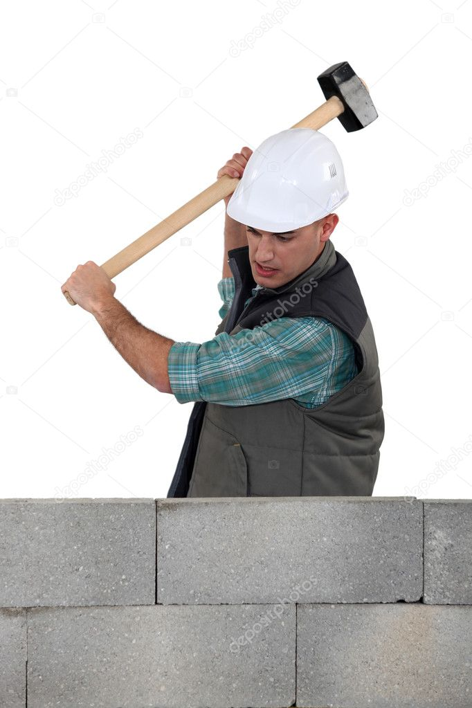 Mason smashing wall — Stock Photo #10015845