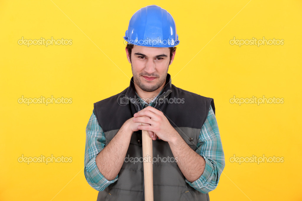 Manual worker stood with large hammer — Stock Photo #10016136