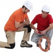 Two plumber preparing copper pipe — Stock Photo