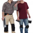 Two tilers ready to start work — Stock Photo #10021148