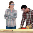 Man and woman using wood plane — Stock Photo #10021189