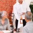 Retired couple in restaurant celebrating anniversary — Stock Photo